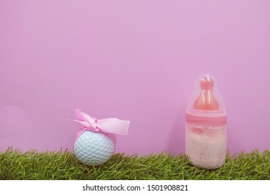 Golf ball with bottle milk on pink background