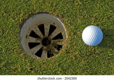 golf ball by the hole