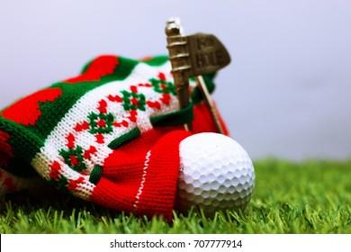 golf ball with christmas bag on green grass