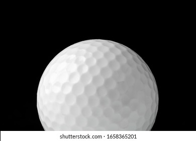 Golf ball close up on black background