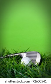 Golf ball and club in the grass on green background with copy space