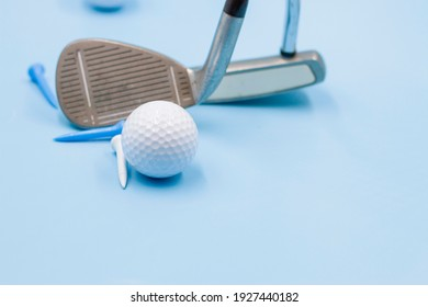 Golf ball with golf club on blue background