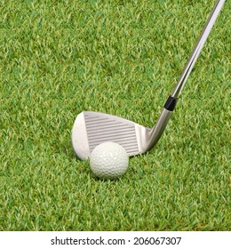 Golf ball with golf club on green grass