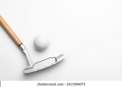 Golf ball and club on white background. Sport equipment