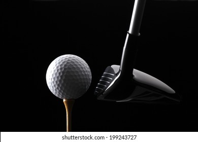 Golf ball club and tee on black background
