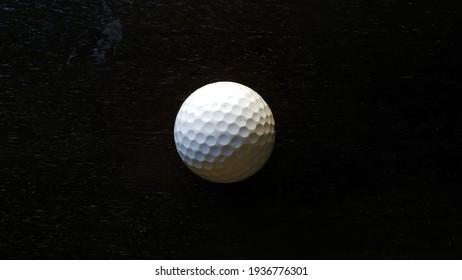 Golf Ball in Dark Background