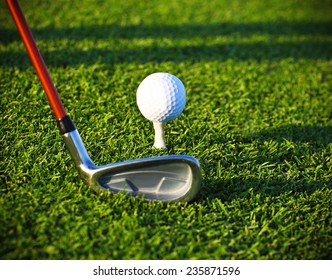 Golf ball and driver on a golf course. Close up