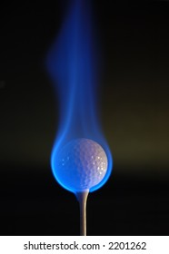 Golf ball engulfed in blue flames. Lighting from the right hand side.