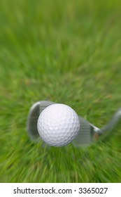 Golf ball frozen in mid air after an iron shot.