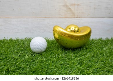 Golf ball and golden ingot for Chinese New Year Holiday to golfer