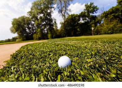 golf ball in the grass, note shallow depth of field