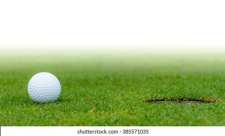A golf ball at the hole.