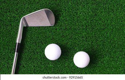 Golf ball and Iron golf club on green fake grass