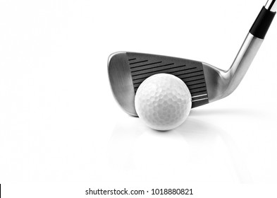 Golf ball and iron on white