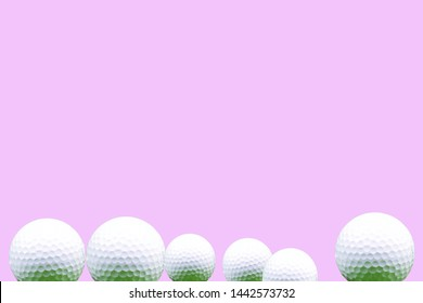 Golf ball isolated on pink background for lady golfer concept