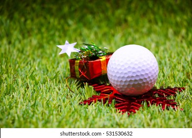 golf ball for Merry Christmas and Happy New year theme on green background.