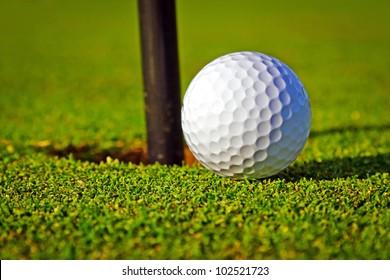 Golf ball near the hole