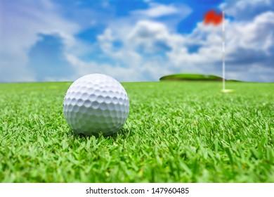 The golf ball near the hole