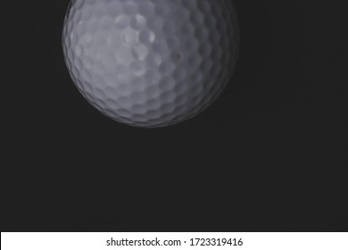 Golf ball on a black background