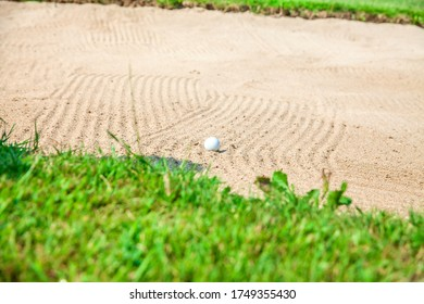 A golf ball on a bunker at Zlati Gric a golf course in Slovenia - Shutterstock ID 1749355430