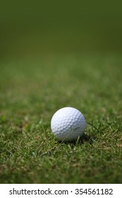 Golf ball on course close-up view