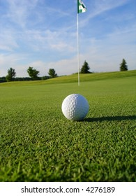 Golf ball on course near hole