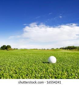 A golf ball on a fairway on a golf couse