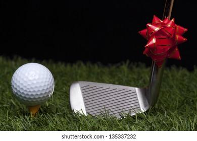 Golf ball on grass on black background.Christmas Gift.
