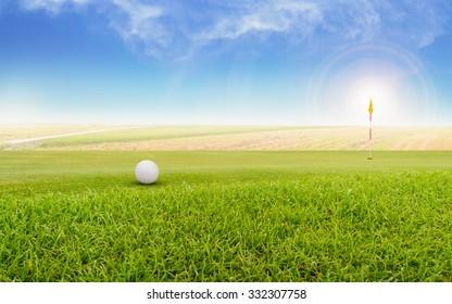 Golf ball on green. Foggy on a golf course.
