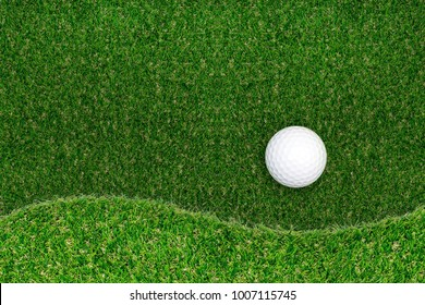 Golf ball on green grass texture background. With curve of green golf court for background.