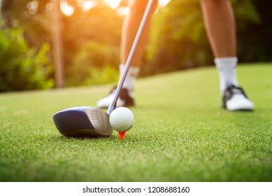 Golf ball on green grass ready to be struck at golf club,close up in golf coures at Thailand