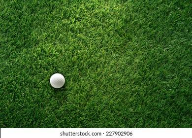Golf ball on green grass in golf course