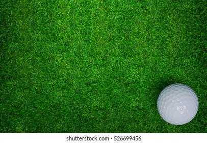 Golf ball on green grass of golf course.