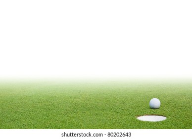Golf ball on green grass and white background