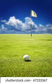 Golf ball on the green  ready to be putt into the hole