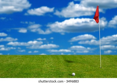 Golf ball on the putting green with sky and clouds in the background