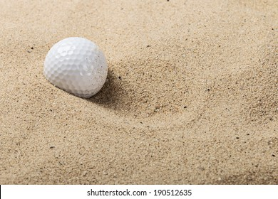 golf ball on the sand background