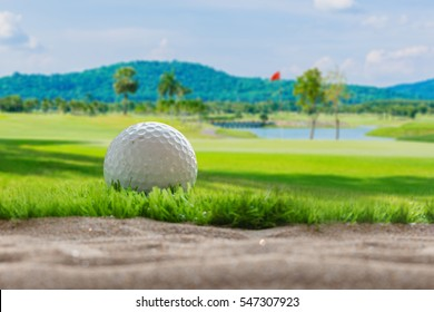Golf ball on sand bunker in golf courses