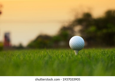 golf ball on tee in a beautiful golf course with morning sunshine.Ready for golf in the first short.Sports that people around the world play during the holidays for health.