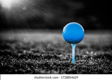 Golf ball on tee ready to be shot Black and white view