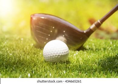 Golf ball on tee ready to be shot on sun set