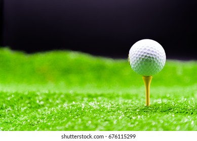 Golf ball on tee for ready to play in golf field