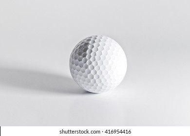golf ball on white background film style
