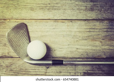 Golf ball on wood table, retro style
