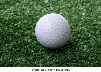 Golf ball ower green grass