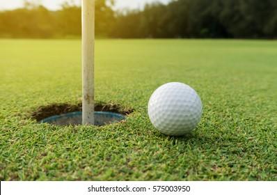 golf ball put position on green rim golf hole