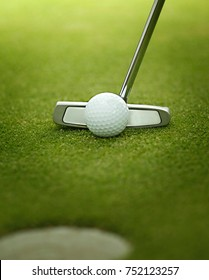 A golf ball is putted with a golf iron, golf club. Putt with putter. golf ball on green.