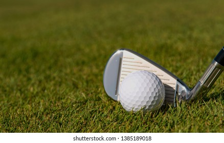 Golf ball ready to be hit by a golf club on a fairway