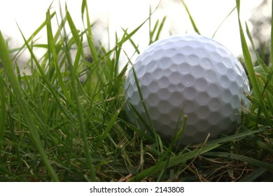 Golf ball in the rough from a low below ground angle
