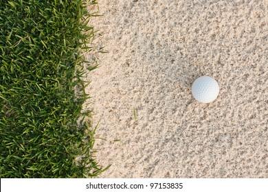 Golf ball  and sand bunker